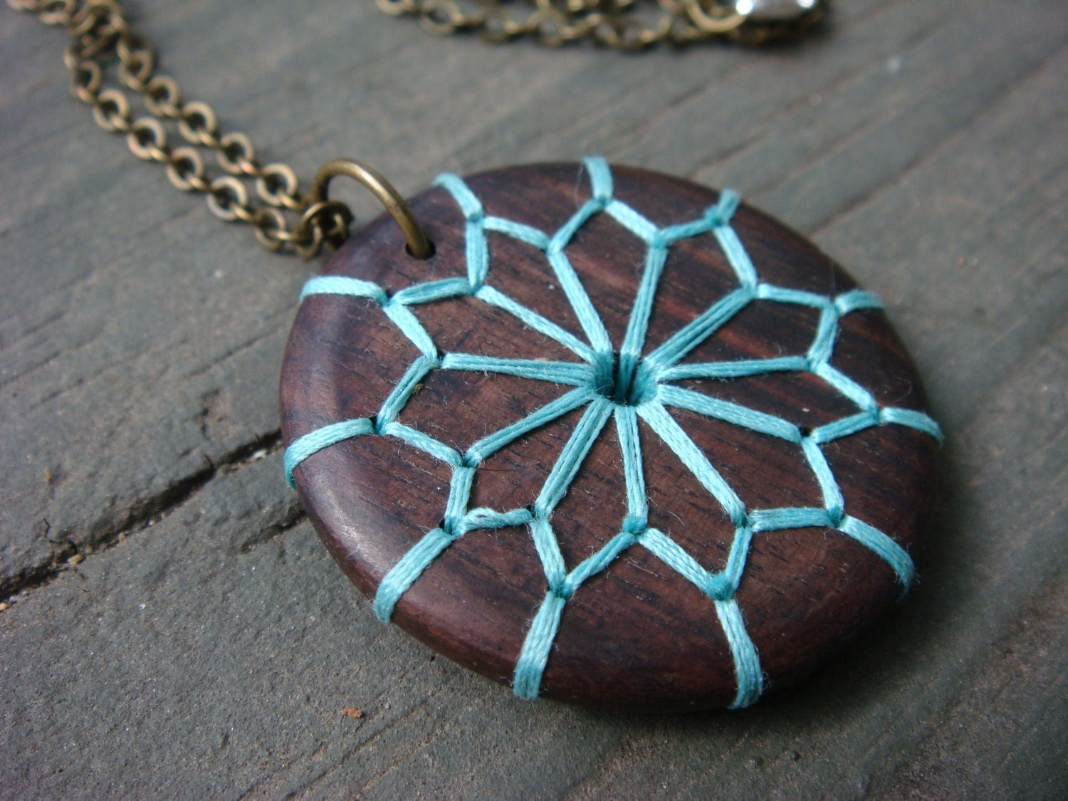 Embroidered wood necklace with geometric floral design for How to make a wooden pendant