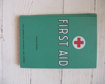 american red cross first aid book hardcover mid century illustrated