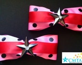 Pink and red hair bows with metal stars. Portion of sale goes to charity.