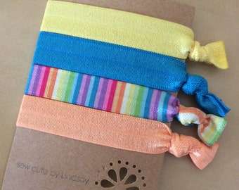 Set of 4 elastic hair ties - yellow, blue, rainbow stripes, orange