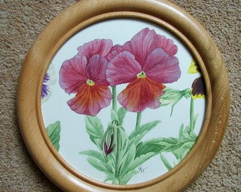 Original watercolour painting of a Pansy. Framed and glazed with a plastic covering.