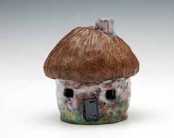 Christmas Village. Round Ceramic Cottage with Thatched Roof inspired by Irelnd..lights up with tea light