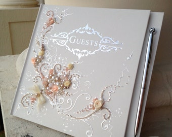 "Beautiful Wedding guest book in peach, champagne and ivory, 10""x11"" with a pen attached or 6""x8.5"", hand decorated with roses and pearls"