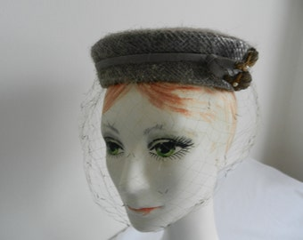 Grey Pillbox Hat with Ribbon and Mettalic Millinery Trim 1950s.