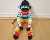 Rainbow sock monkey plush with stripes and polka dots
