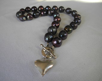 Large peacock pearls with silver heart pendant