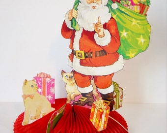 Vintage Santa's Visit Honeycomb Christmas Decoration Die Cut Centerpiece Santa Claus Cats Toys Red Green White American Greetings 1980's
