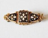 Tiny enamel brooch
