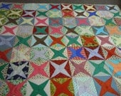 Quilt: Colorful vintage scrappy star quilt in cotton fabrics  1960's