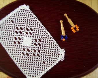 Miniature lace bobbins with spangles