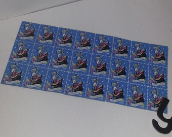 Y Vintage paper supplies Easter Seals Christmas stamps sheet of 24 from 1946 blue color scrapbook altered art