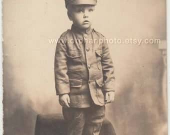 Vintage/Antique beautiful postcard photo of a cute boy wearing a military costume