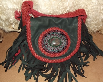 Dark forest green deer skin bag with pipestone red deer lacing, soft and supple.