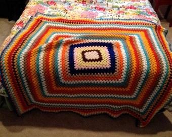 Multi colored  granny square afghan blanket crocheted vintage red blue pink orange rainbow