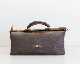 vintage dark brown leather gladstone bag, embossed GHC in gold