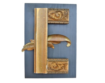 original sign letter, GOLD, letter E, made with vintage salvaged parts  by Elizabeth Rosen