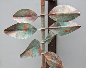 "This wind sculpture, ""Leaves"", consists of  aluminum mounting bracket and copper spinner complete w/ 2 internal ball bearings. Sale price!"