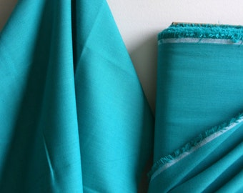 Organic Solid Fabric in Turquoise from the Cirrus Solids Collection from Cloud9 Fabrics. - ONE  HALF YARD Cut