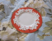 10 inch large ceramic plate handmade in Japan orange white flower border wall hanging holes punched dinner