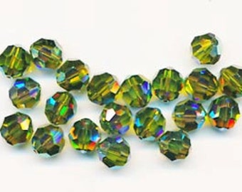 Twelve dazzling limited edition Swarovski crystals: art 5000 - 8 mm - olivine AB 2X