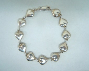Hearts Charm Linked Sterling Silver Bracelet