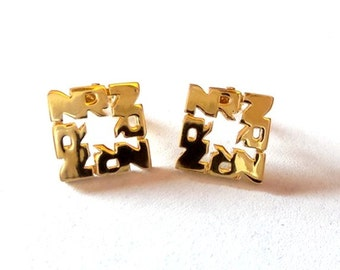 Nina Ricci Designer Clip Earrings.Gold tone.NR monogrammed