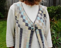 Crochet pattern for an Entrelac cotton vest using a simple tunisian stitch and a standard crochet hook.