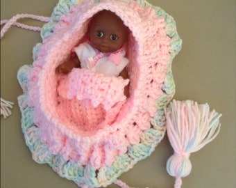 Pink crochet cradle purse with adorable african american baby doll