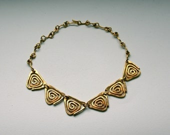 1960s Modernist  necklace made of hammered brass abstract geometric design
