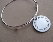"""SALE- Hand-Stamped Bangle Bracelet- """"don't dwell on the past""""- ONLY 1 Available"""