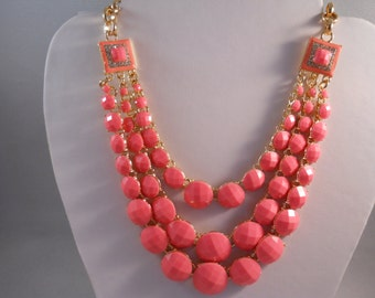 3 Row Necklace with Gold Tone and Pink Beads on a Gold Tone Chain