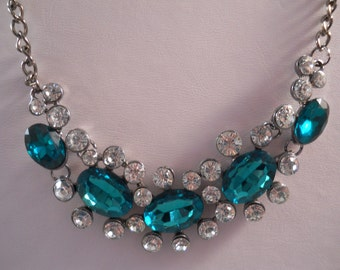 Green Crystal and Clear Rhinestones Pendants on a Grey Tone Chain