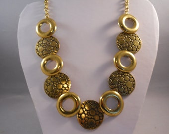 Bib Necklace with Gold Tone Pendant Beads on a Gold Tone Chain