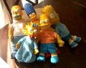 The Simpsons family minus Lisa dolls.