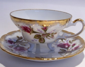 Rose and Gold Tea Cup with Three Feet and Saucer