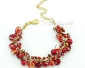 Red coral,crystal on silk bracelet.