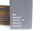 Funny Gift: Grey MOLESKINE® notebook to keep all newly learnt fancy words handy before an interview or a date!