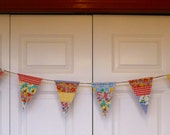Vintage feedsack quilt made into banner flags, reversible as back is done in batik.