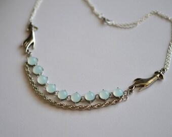 Aqua and hands necklace