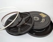 """Vintage 8 MM film in Canister. """"1970's Christmas, Cabin in Winter, Wedding, Montana Trip"""""""