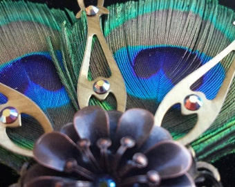 Peacock bloom, hat pin, clock hands