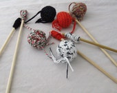 Cute crocheted cat toy on a stick