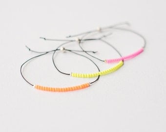 Set of 3 cord bracelets with neon beads