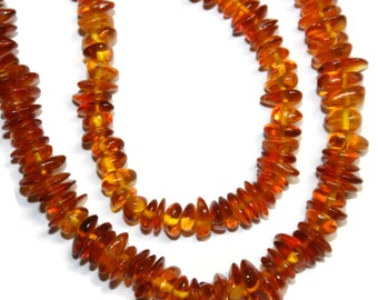 Baltic amber smooth chips, AA+ grade.  Approx. 7-12mm.   Select a strand length.