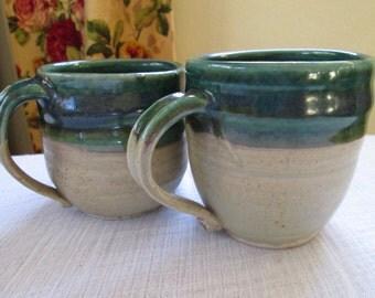 A pretty pair of handmade stoneware ceramic pottery cups/mugs