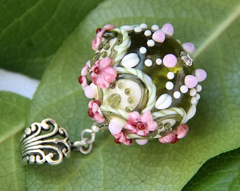 Lampwork glass pendant #3 with small flowers. Pink and green color. Baroque style.