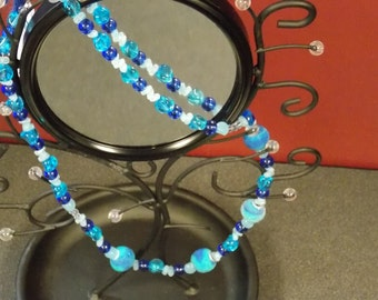 Long, various blues necklace