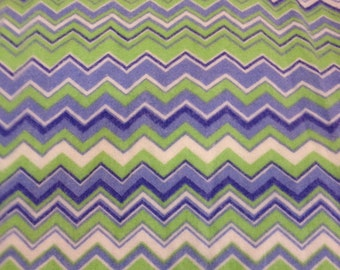 A chevron print in perwinkle blue and green fitted crib /toddler sheet