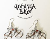 Copper/silver wire + orange bead bicycle earrings // Made in Kenya