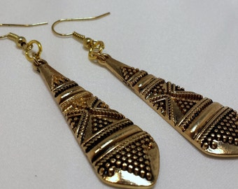 Gold and black dangle earrings.